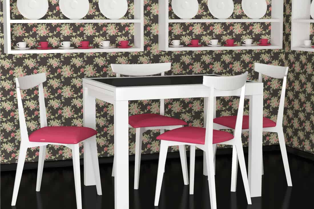 Vintage dining room with floral cottagecore design wallpaper, black tabletop and floor, white chairs and floating cabinet