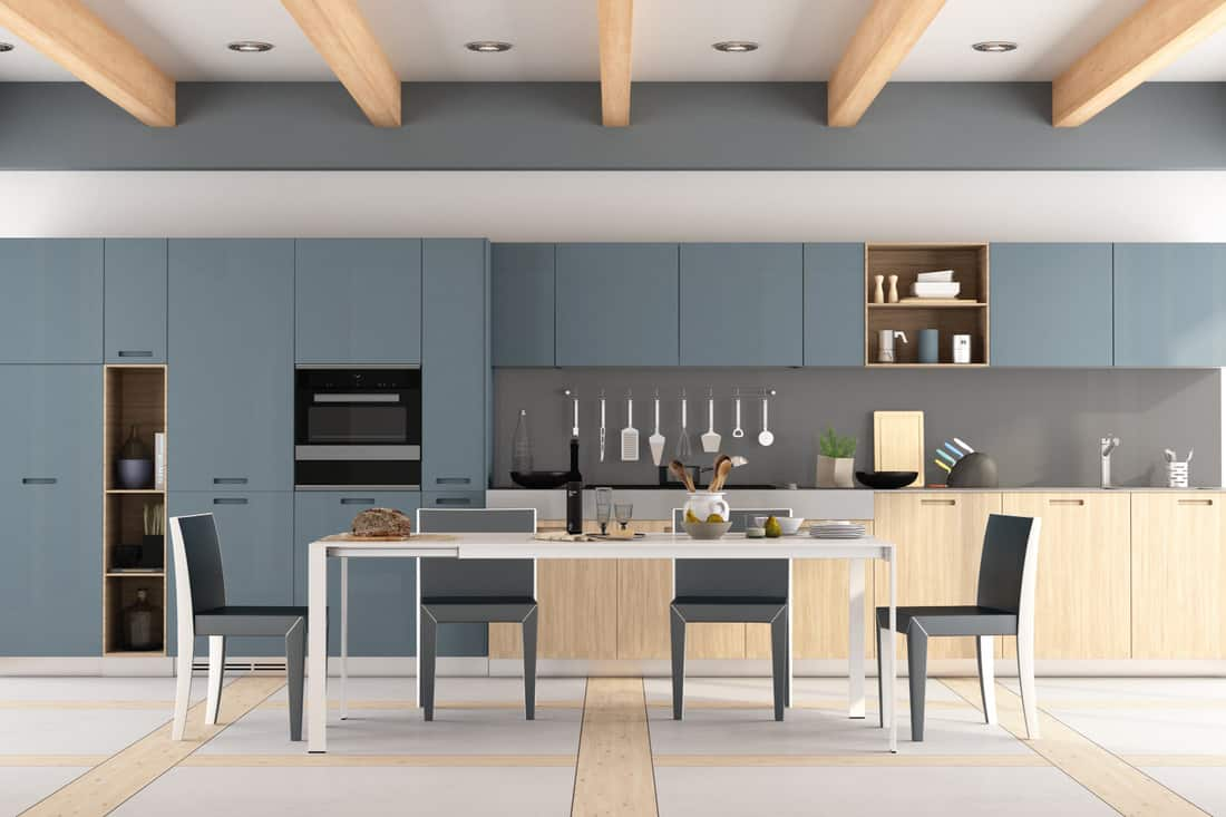 Wooden and blue kitchen with dining table and chairs