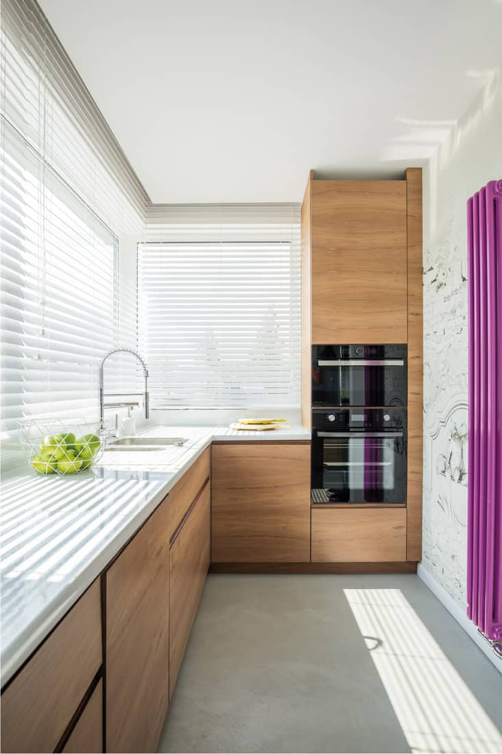 Wooden kitchen interior with no pulls on the cabinets