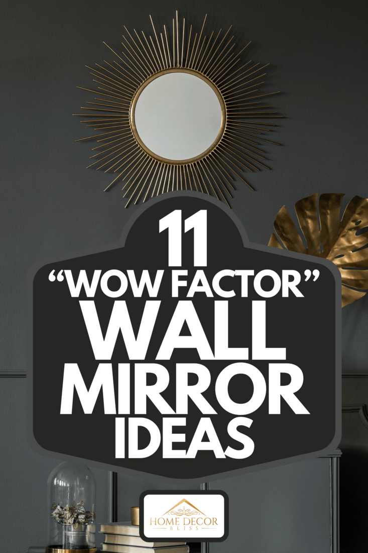 """A decorative mirror above a golden plant leaf in a dark luxurious apartment interior, 11 """"Wow Factor"""" Wall Mirror Ideas"""