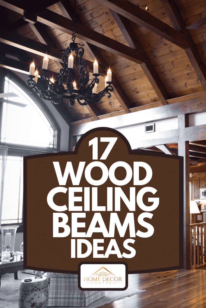 A living room with a beautiful stone fireplace and wooden beams, 17 Wood Ceiling Beams Ideas