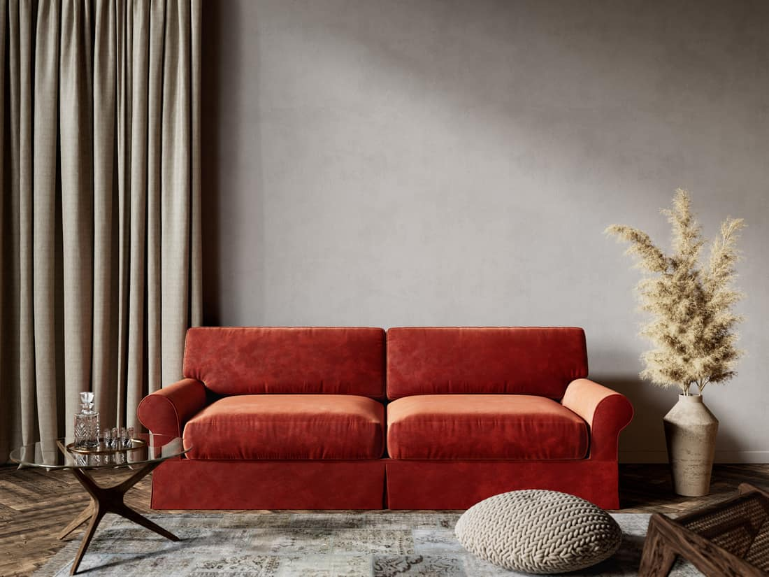 A couch with an empty wall behind, a sofa with a space above the owner needs to fill