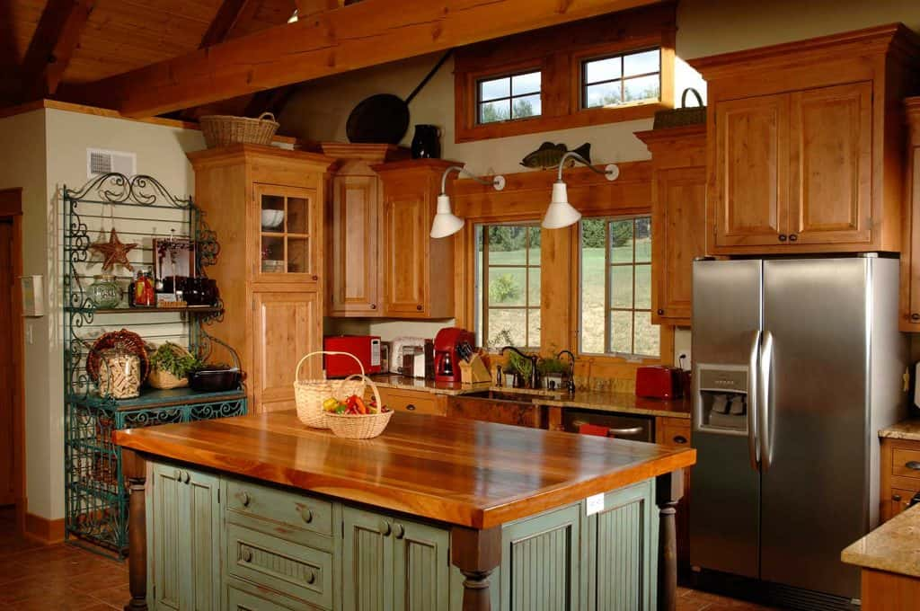 A country kitchen with a beautiful wooden island table