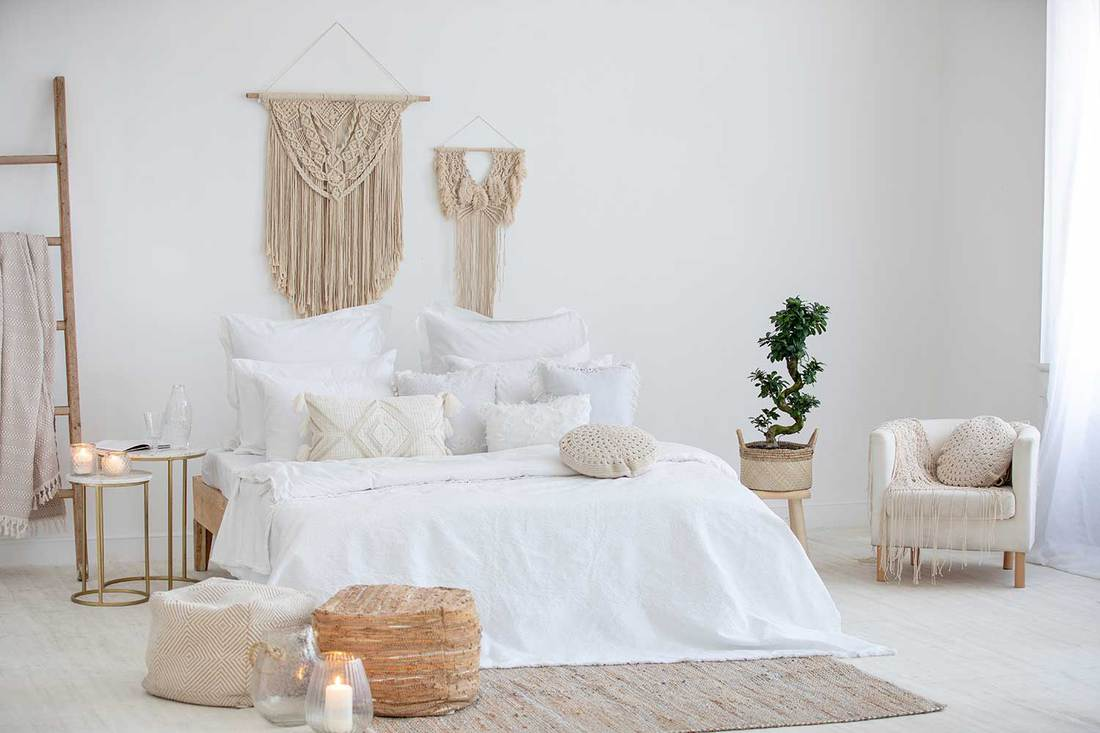 A cozy bedroom design in white and cream colors