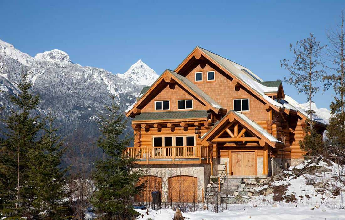 A west coast wooden house during winter in mountains