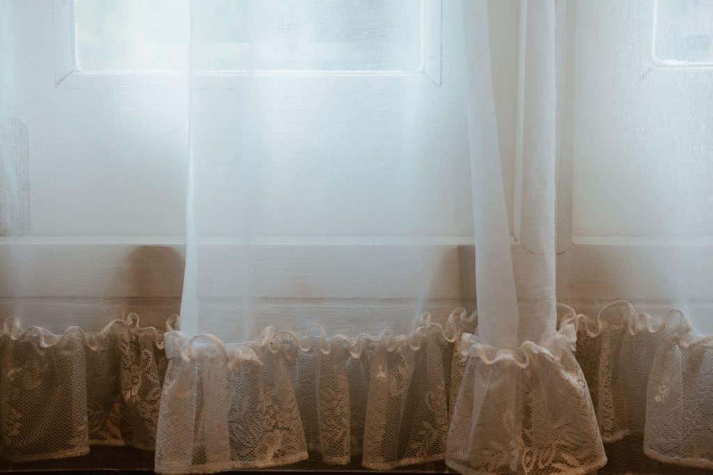 A white see through curtain