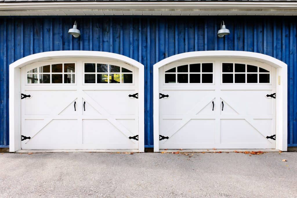 A white two car garage doors with blue painted sidings