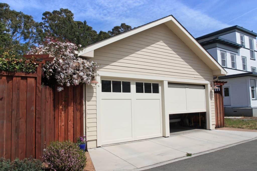 A white two garage door with sliding up doors