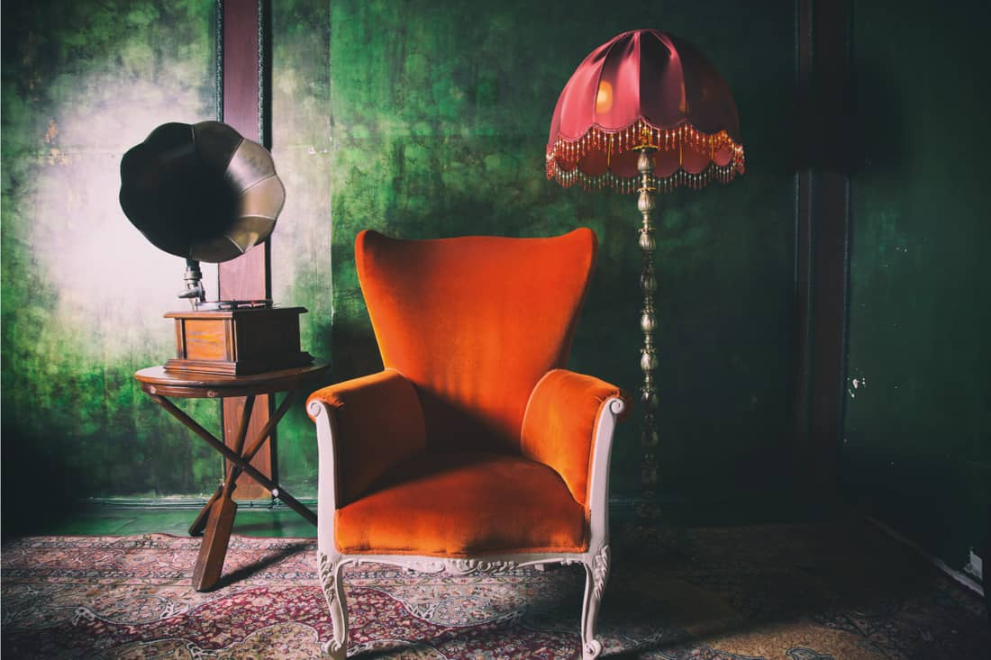 Orange seat with gramophone and lampshade
