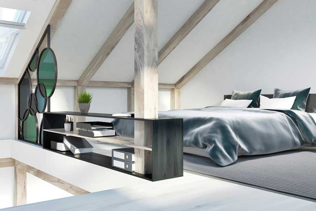 Attic bedroom corner with a modern bed and bookshelf