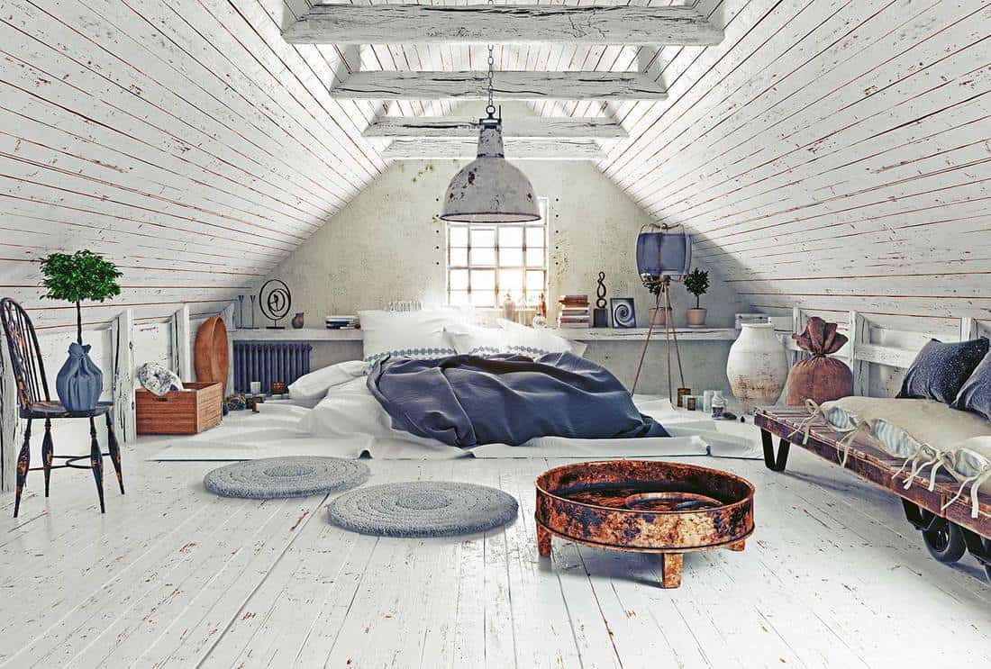 Attic bedroom with rustic design interior