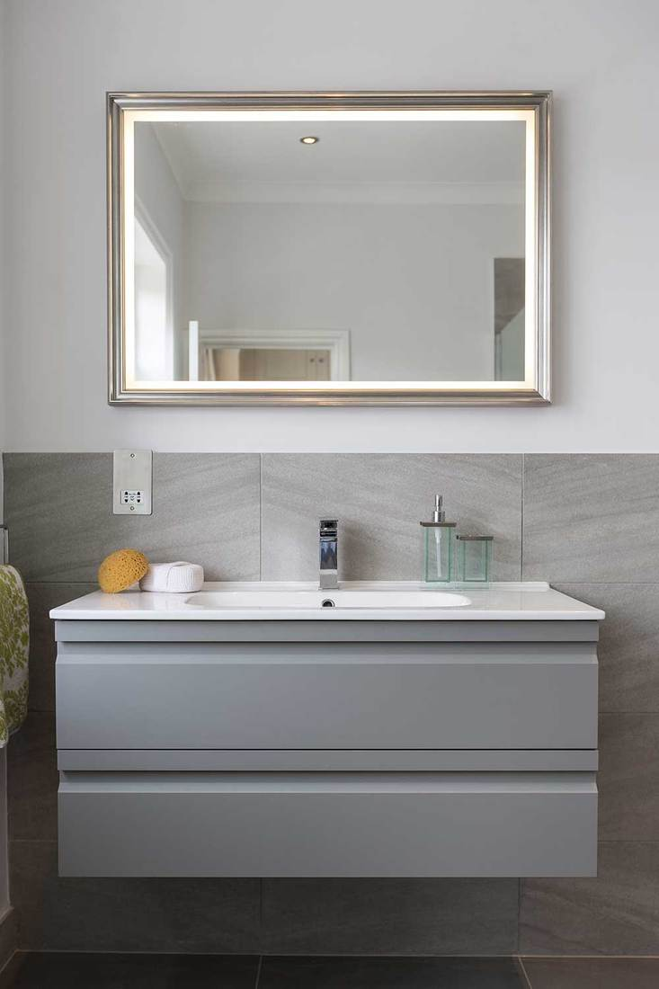 Bathroom sink and mirror with hand towel and sponge