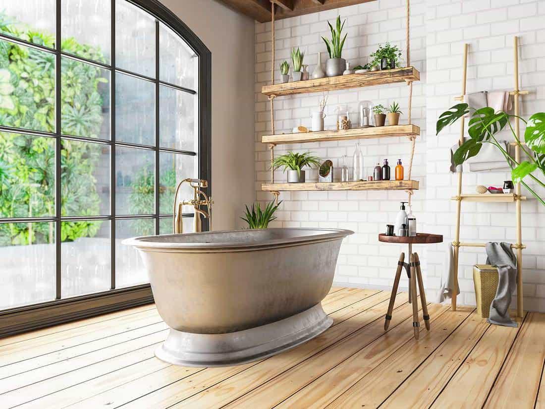 Bathtub in the loft interior bathroom with hardwood floor