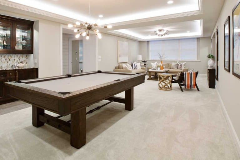 Beautiful basement entertaining room with LED lighting in tray ceiling, 11 Stunning Basement Flooring Ideas