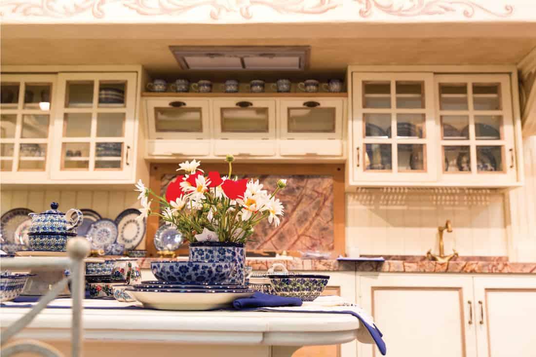 Beautiful custom kitchen with Blue floral print, blue brown pattern backsplash