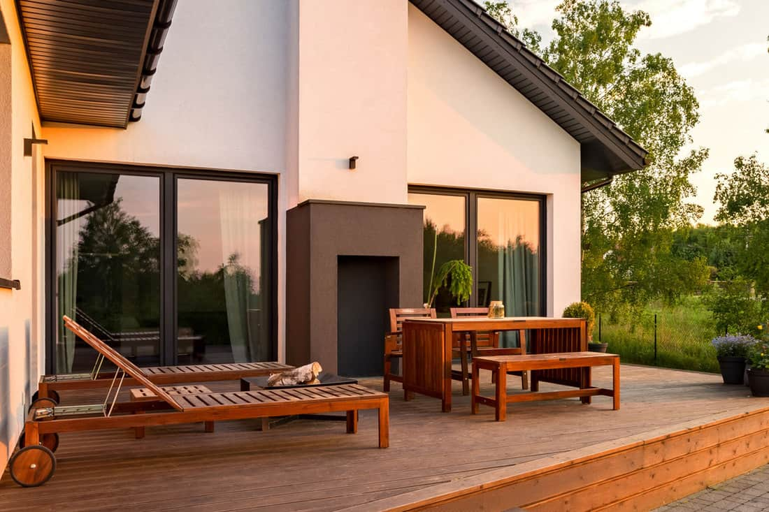 Beautiful exterior view of modern villa with terrace with wood furniture for outdoors, 3 Methods To Waterproof Wood Furniture For Outdoors