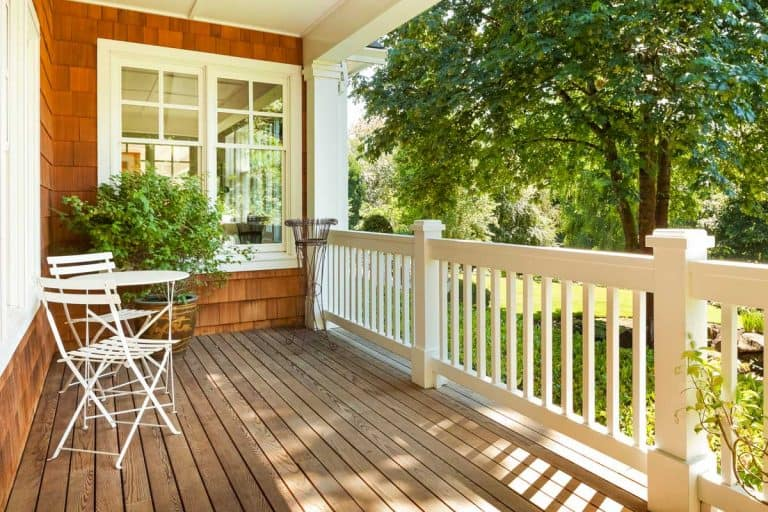 Beautiful front porch with table and chairs, on a lovely summer day, 100 Fabulous Front Porch Ideas