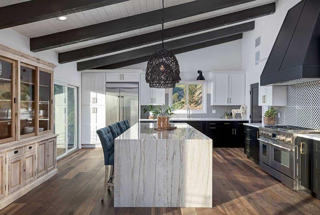 Beautiful modern kitchen with hardwood floor and island table