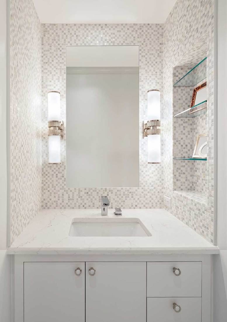 Beautiful remodeled bathroom in a condominium with white cabinets