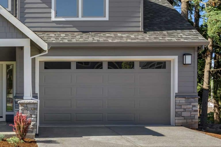 Beautiful residential gray home garage on bright sunny day, What Paint Finish Is Best For Garage Doors?