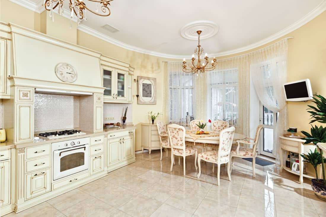 Beige floral country kitchen. Classic style kitchen and dining room