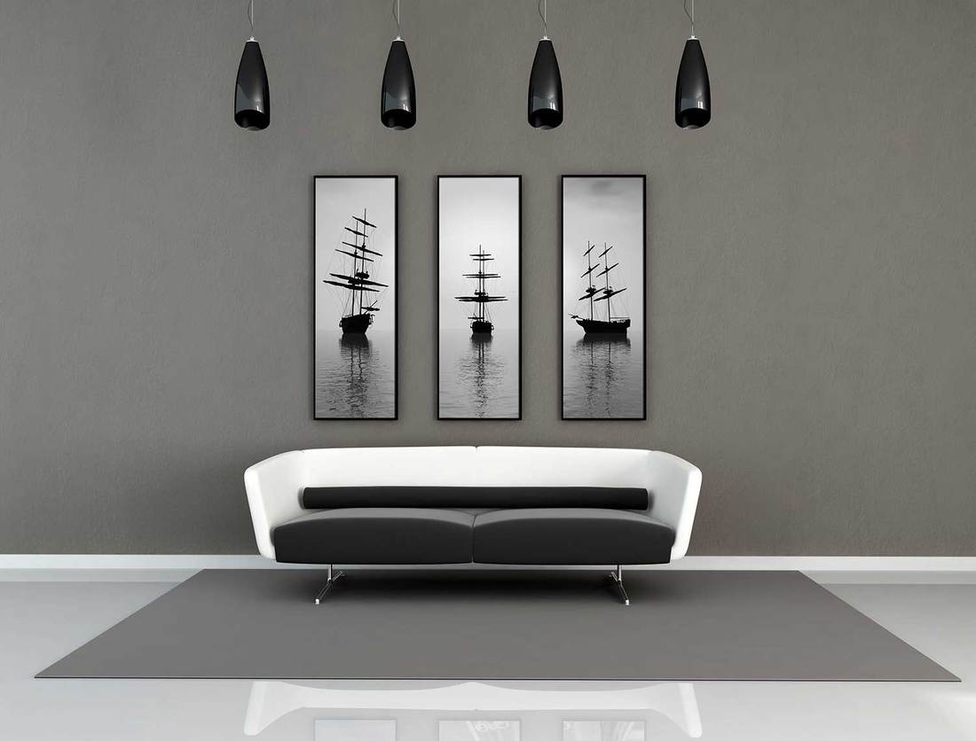 Black and white modern interior living room with gray carpet on tile floor and framed artwork on wall