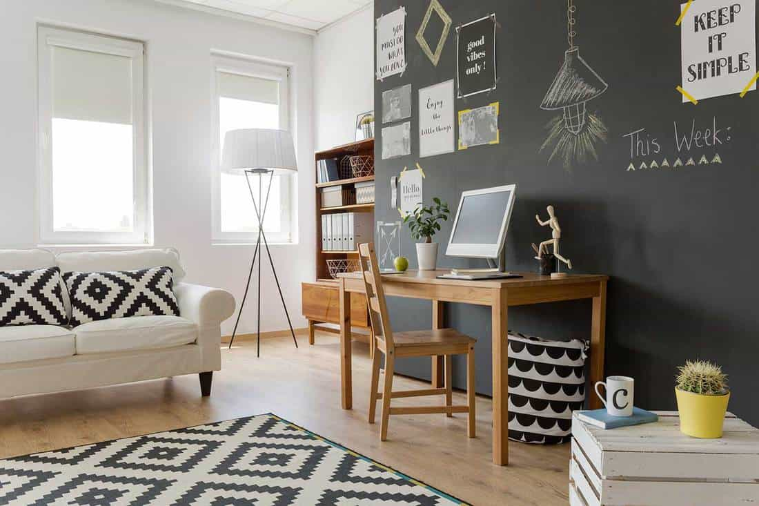 Black and white mosaic theme living room with vinyl floor and chalkboard wall