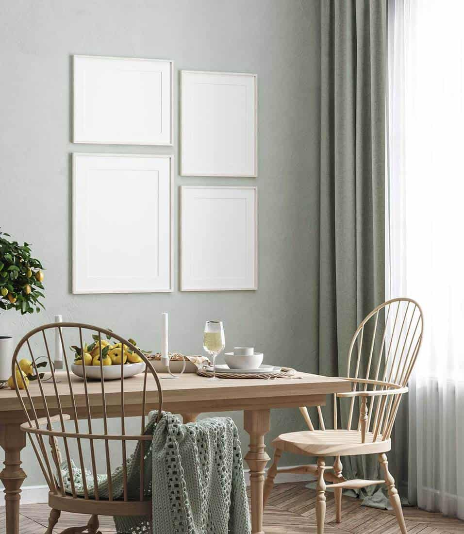 Blank frame in Scandinavian style home interior dining room