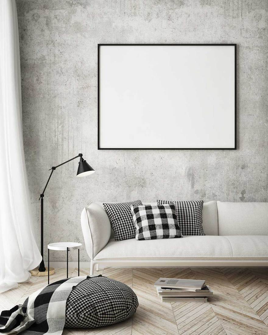 Blank poster frame on wall in Scandinavian style living room with parquet floor