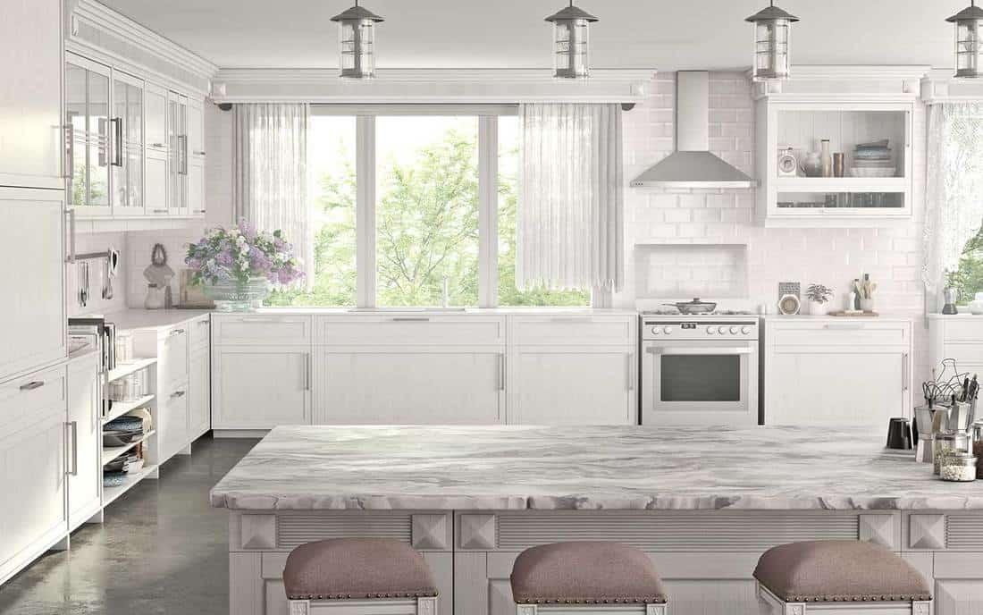 Bright kitchen interior design with island and white cabinets