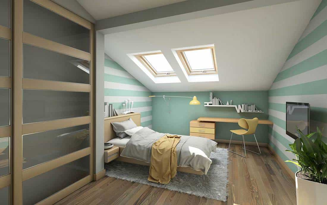 Bright teenager's room on attic with study table