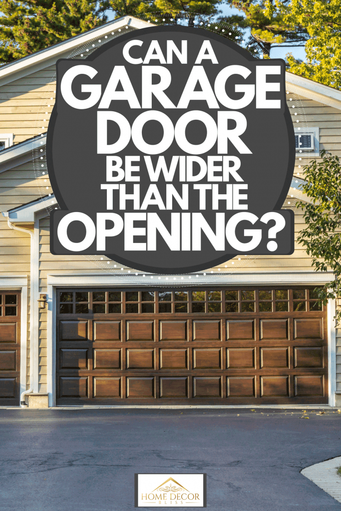 A gorgeous two storey house with cream colored wooden sidings, brown painted garage doors, and a white driveway, Can A Garage Door Be Wider Than The Opening?