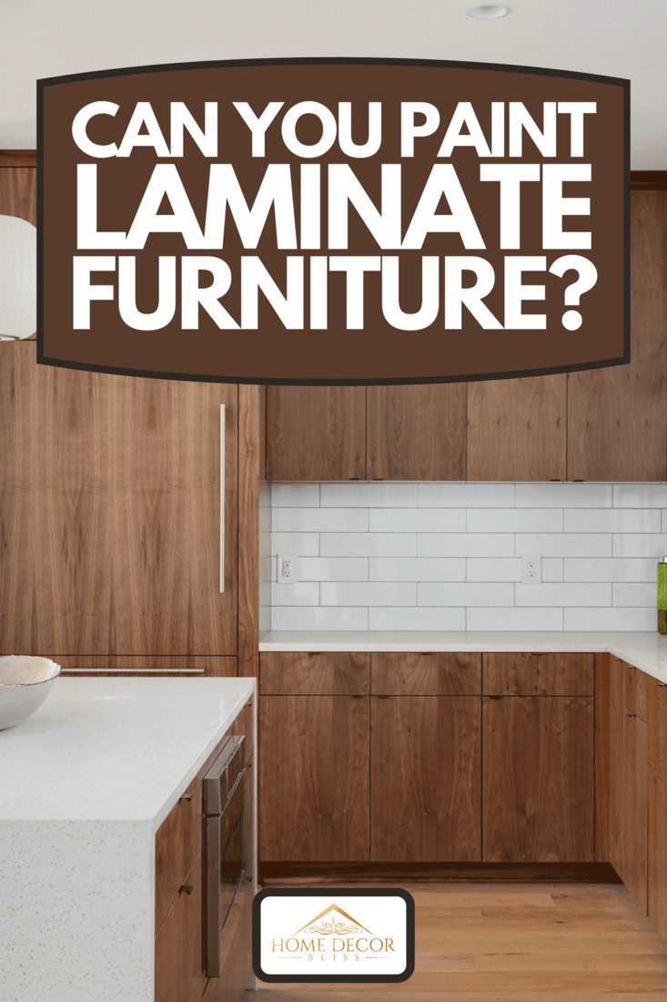 A modern kitchen with laminated wood cabinets, Can You Paint Laminate Furniture?