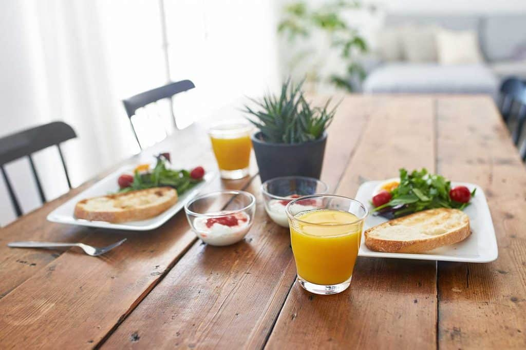 Close-up of fresh breakfast served on wooden table
