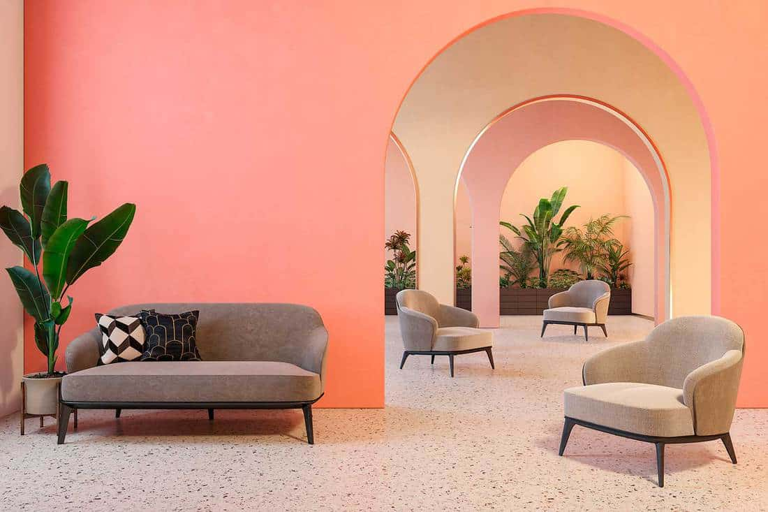 Colorful interior with archs, sofa, armchairs, terrazzo floor and plants