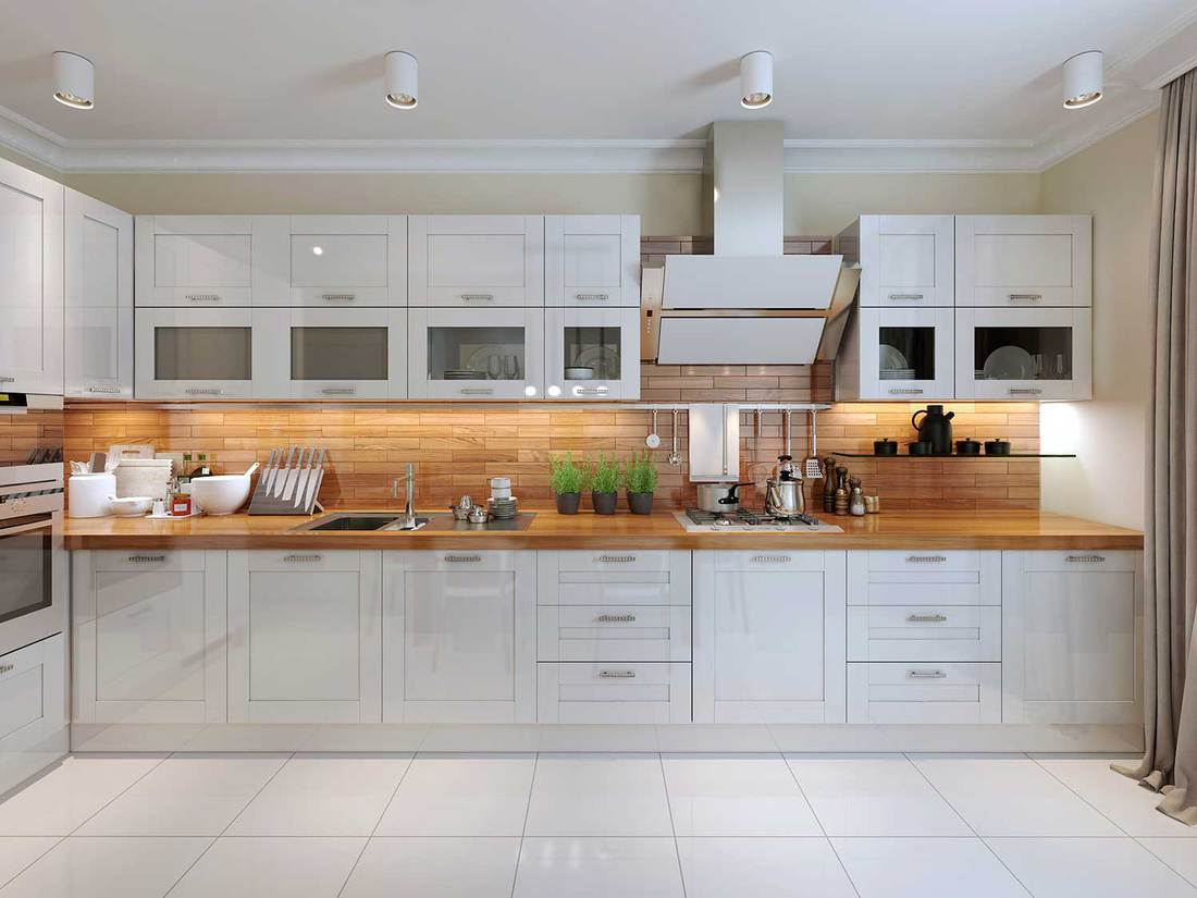 Contemporary style kitchen interior with white tile flooring