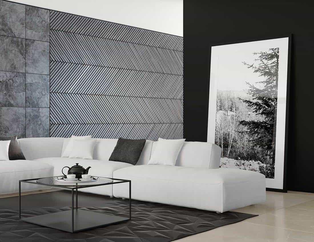 Contemporary villa living room interior with dark wall, light marble floor, white sofa, leather carpet and framed artwork