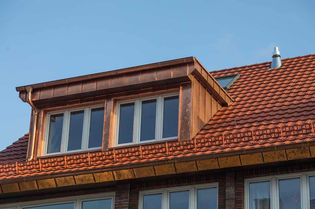 Copper dormer on rooftop of apartment house