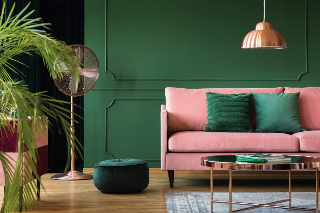 Copper lamp and table in a green living room