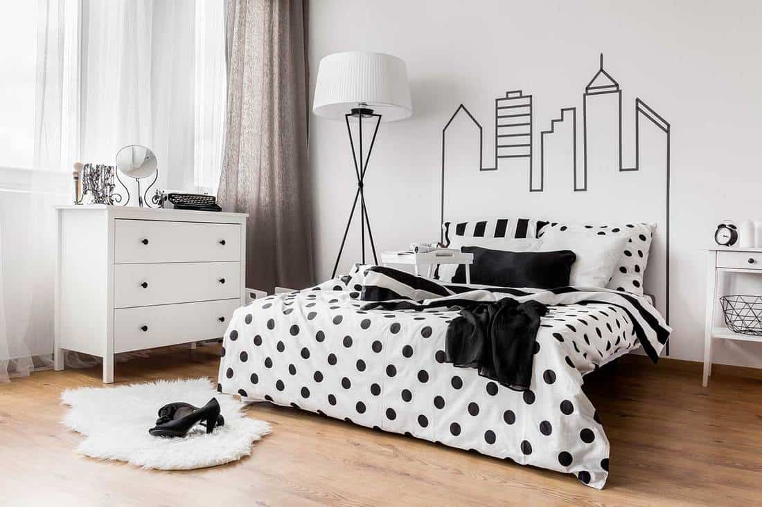Creative black and white female bedroom