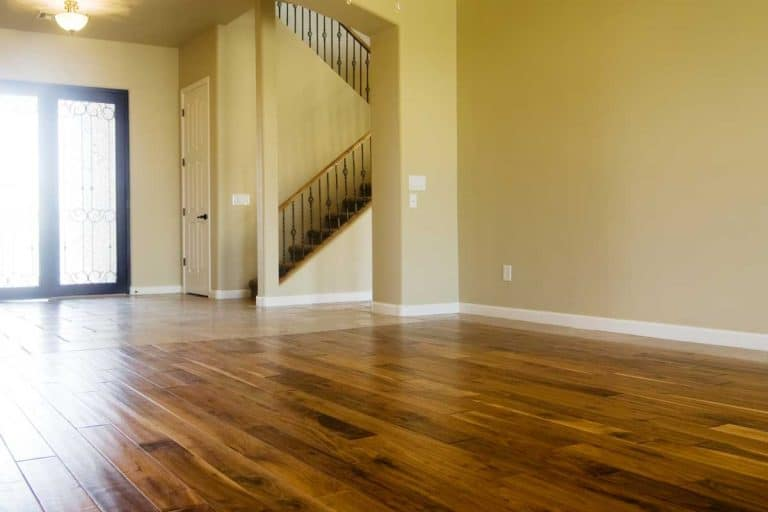 Dark stained hardwood flooring in kitchen area of new home, 17 Stunning Hardwood Floor And Wall Color Combinations