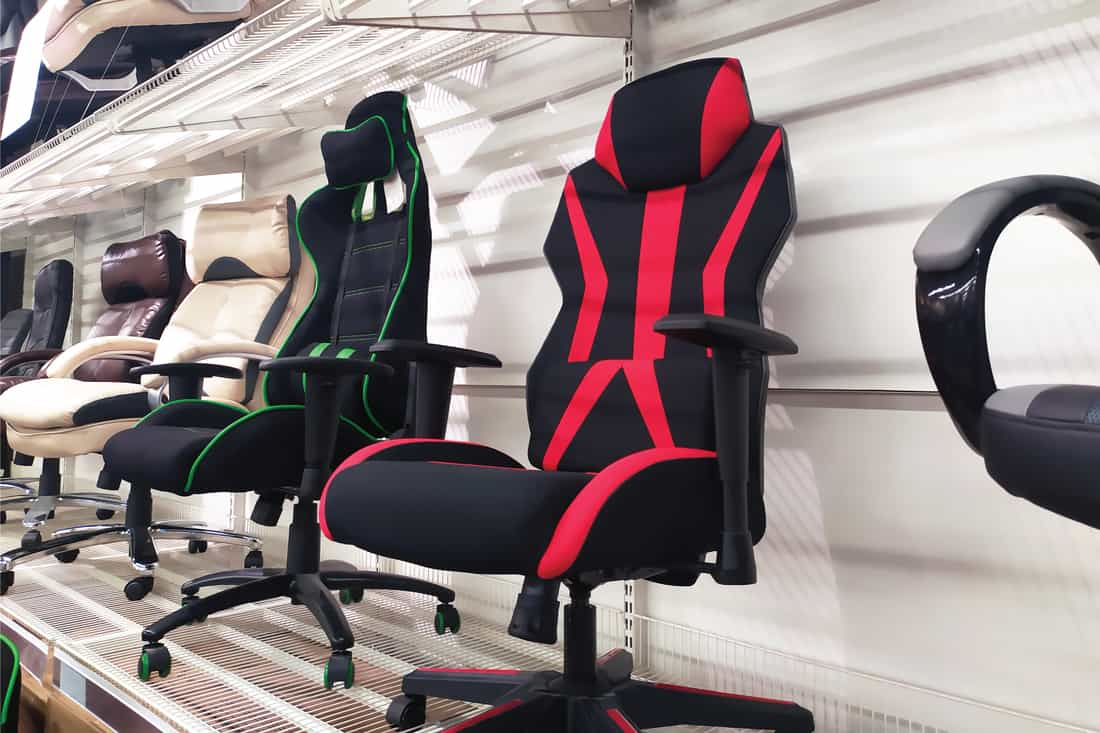Different computer gamer soft ergonomic chairs in the furniture store
