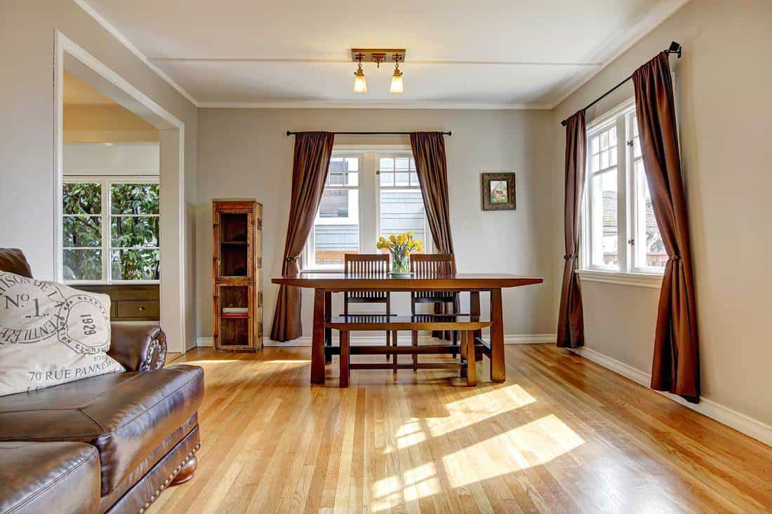Dining room with brown curtain and hardwood floor