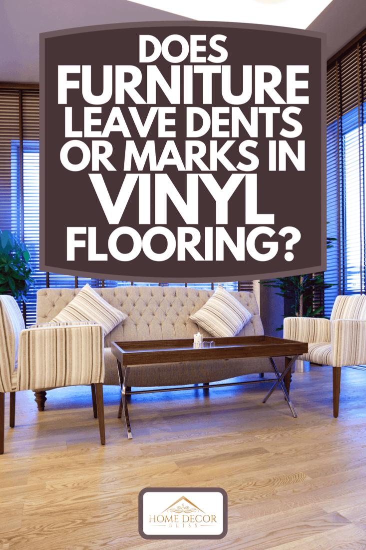 A hardwood brown vinyl flooring of a modern living room with furniture, Does Furniture Leave Dents Or Marks In Vinyl Flooring?