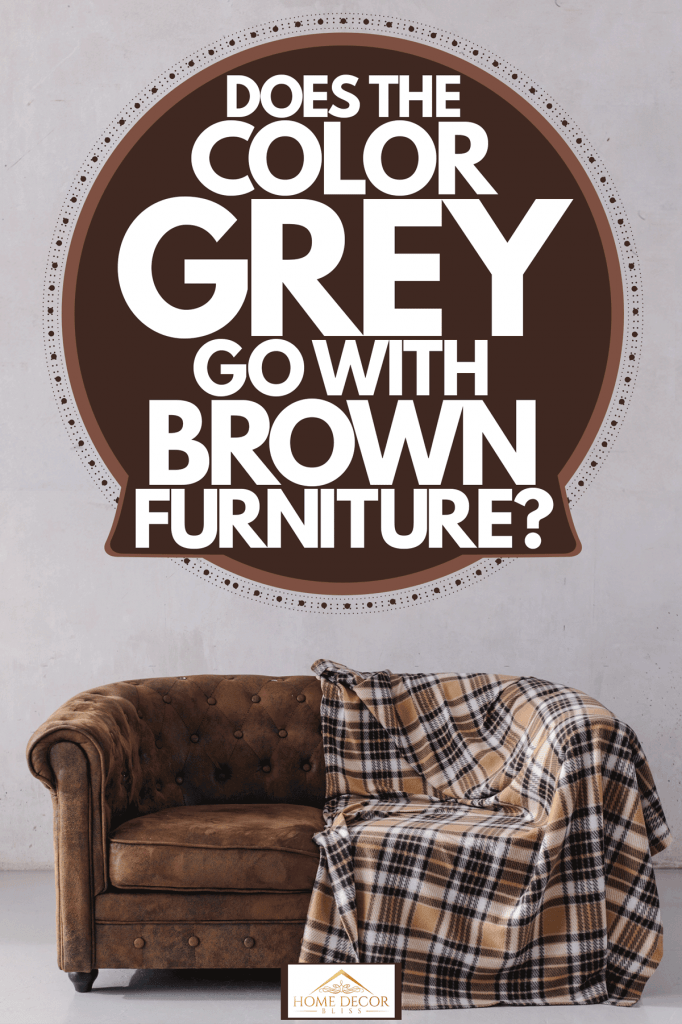 A brown sofa with a brown checkered blanket on it inside a gray living room, Does The Color Grey Go With Brown Furniture?