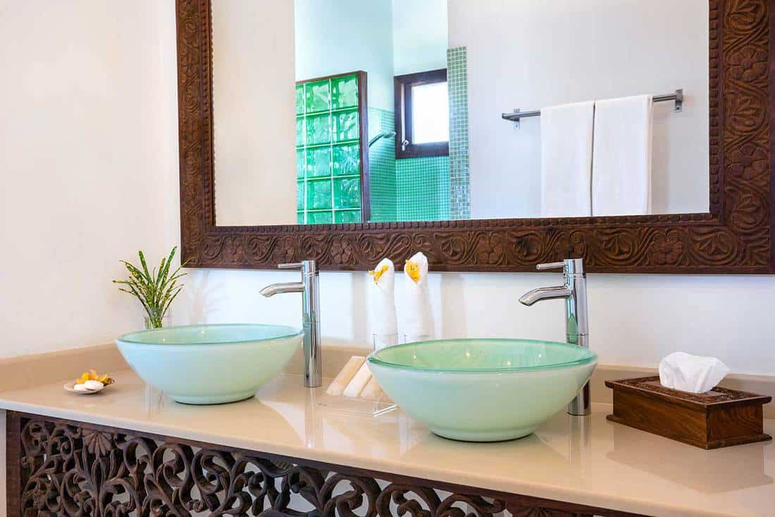 Double sink bathroom with large mirror in luxury villa