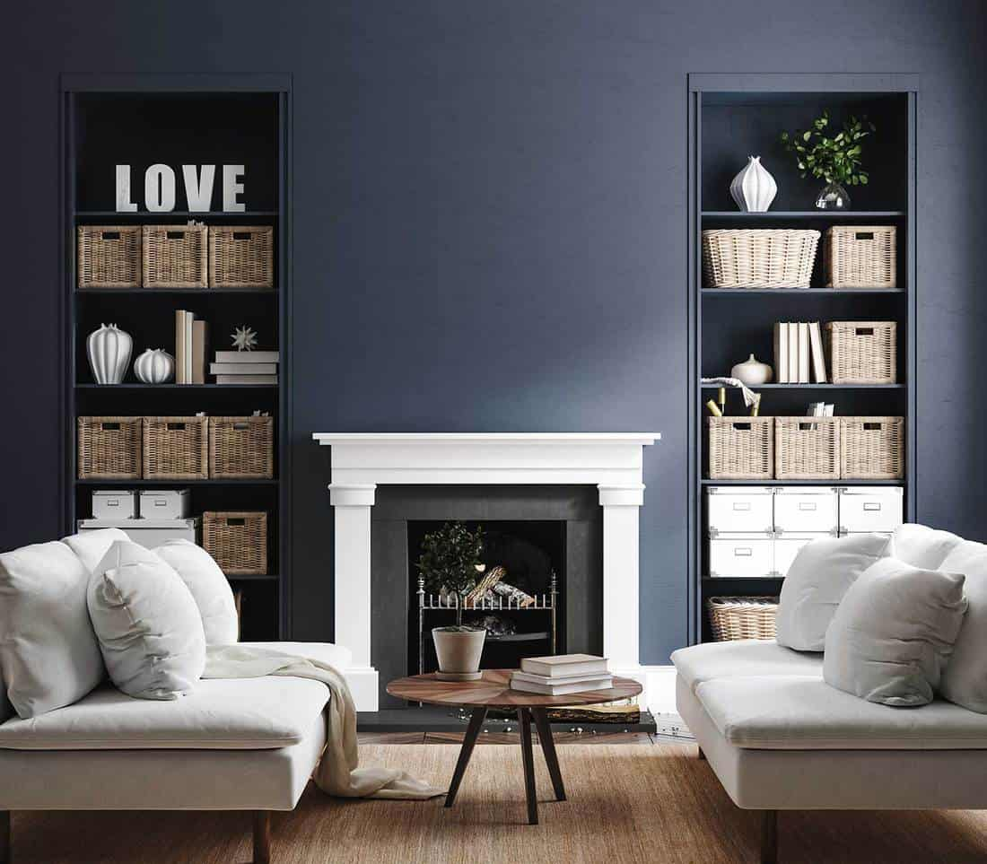 Eclectic home living room interior in classic blue color wall with fireplace