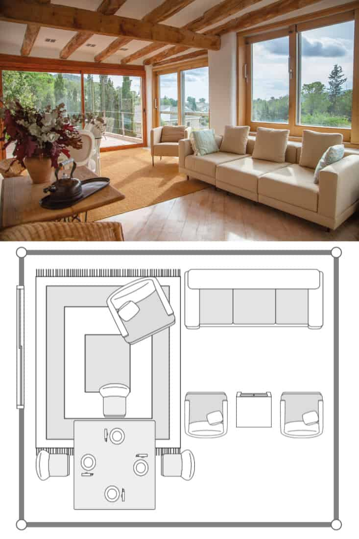 Elegant farmhouse second living area with sofas and easy chairs and patio doors on to upper terrace