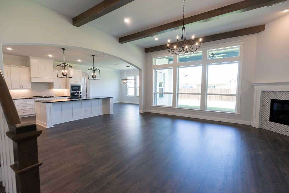 Empty living area and kitchen inside of a new modern home