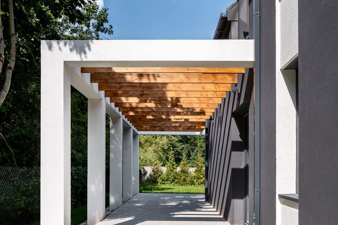 Exterior view of stylish house terrace with wooden pillars on ceiling and cobblestone floor